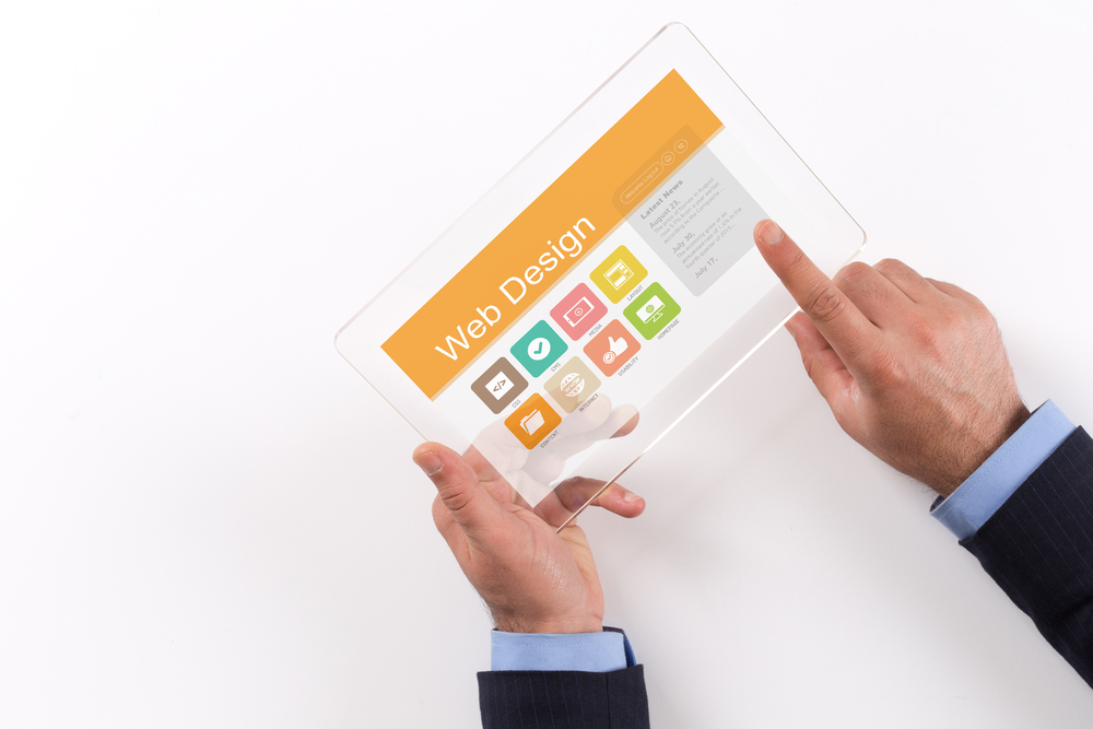 Hand Holding Transparent Tablet PC with Web Design screen