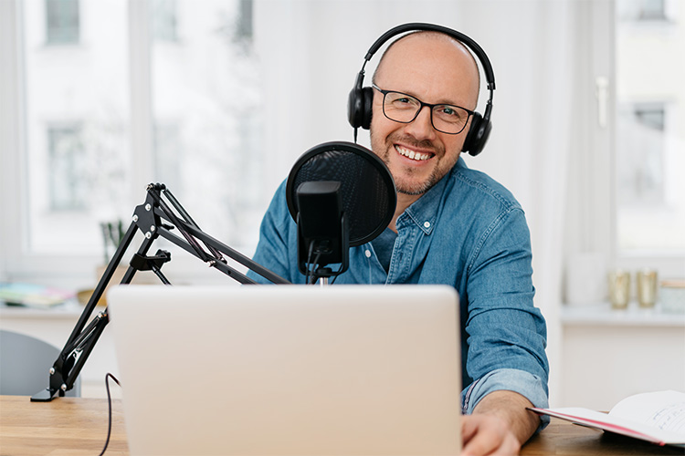bald man working with recording equipment