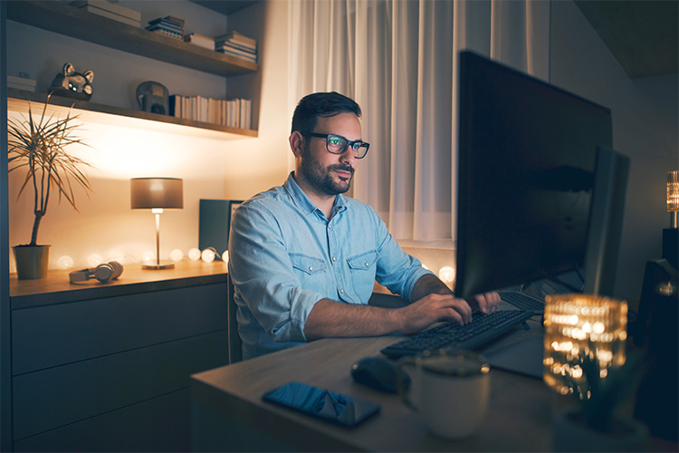 smart young man working in a desktop