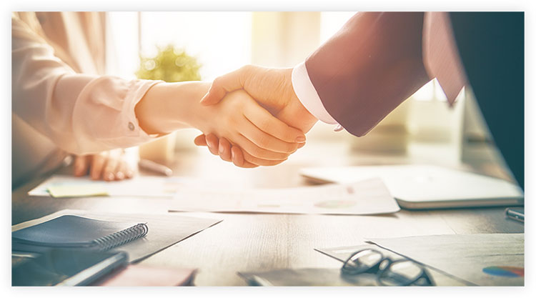 persons shaking hands to build sales relationship